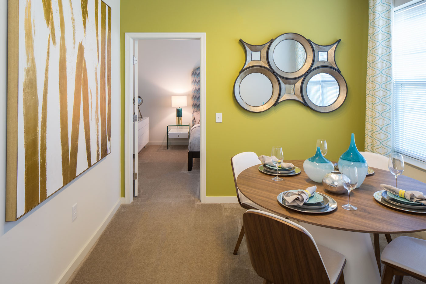 dining area with tables, chairs, modern artwork, windows and a view of the bedroom - christiana mall apartments