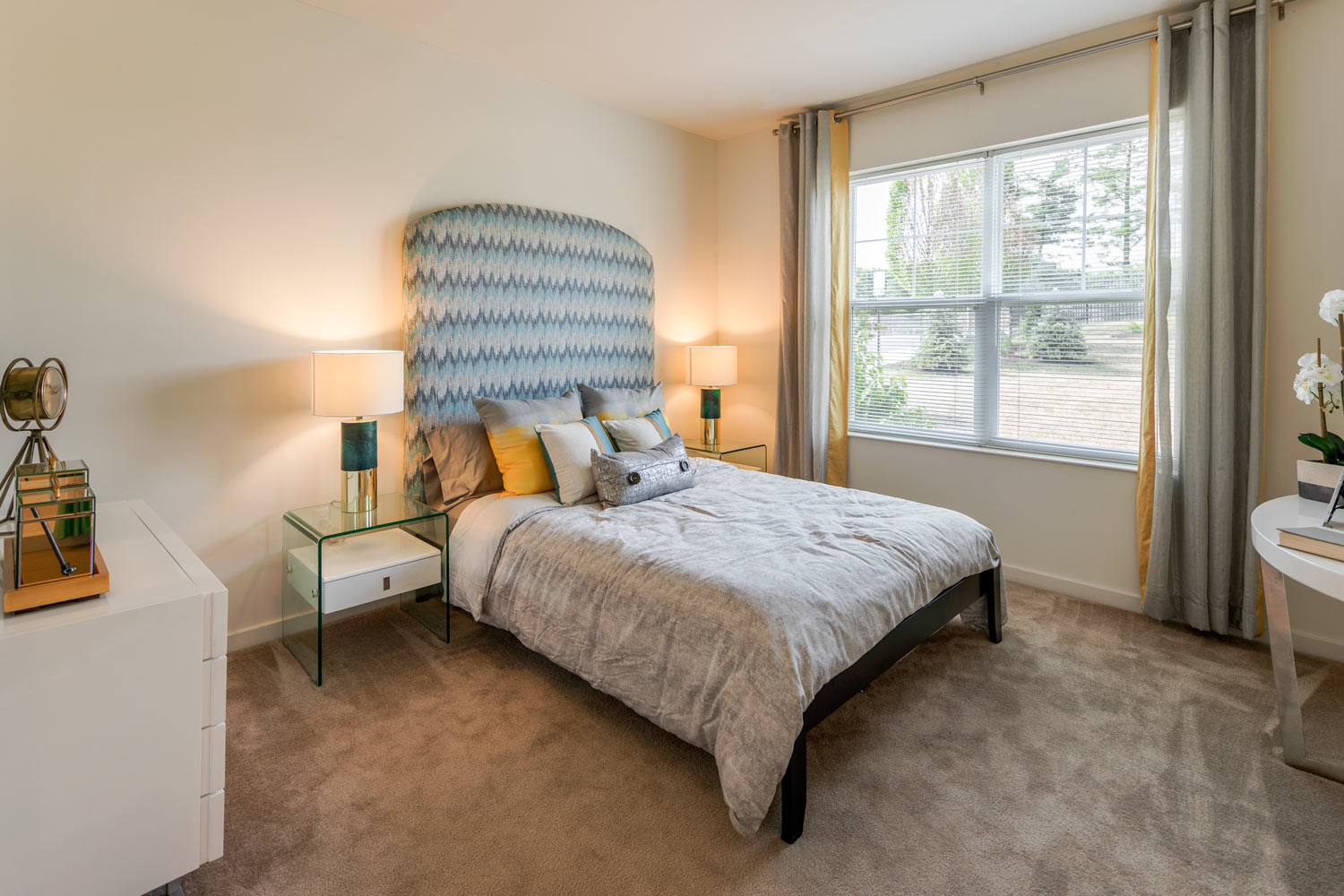 bedroom with bed, night stands, dresser and large window - newark de apartments