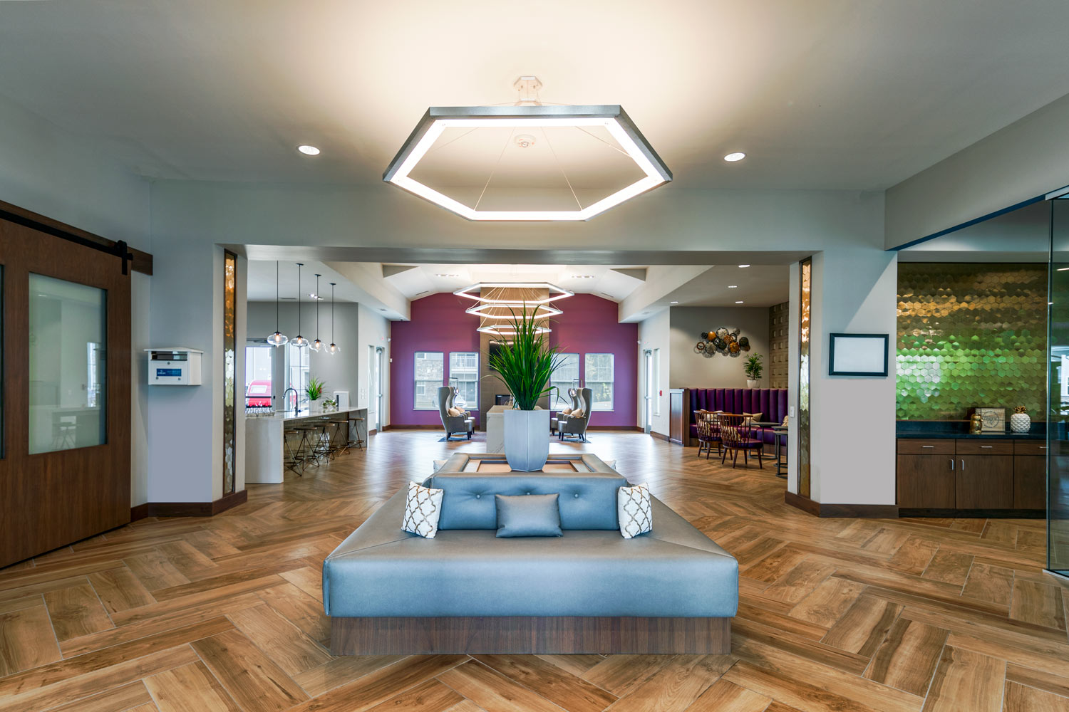 clubhouse with bench seating area, tables, chairs, modern lighting and bar area - luxury apartments near christiana mall
