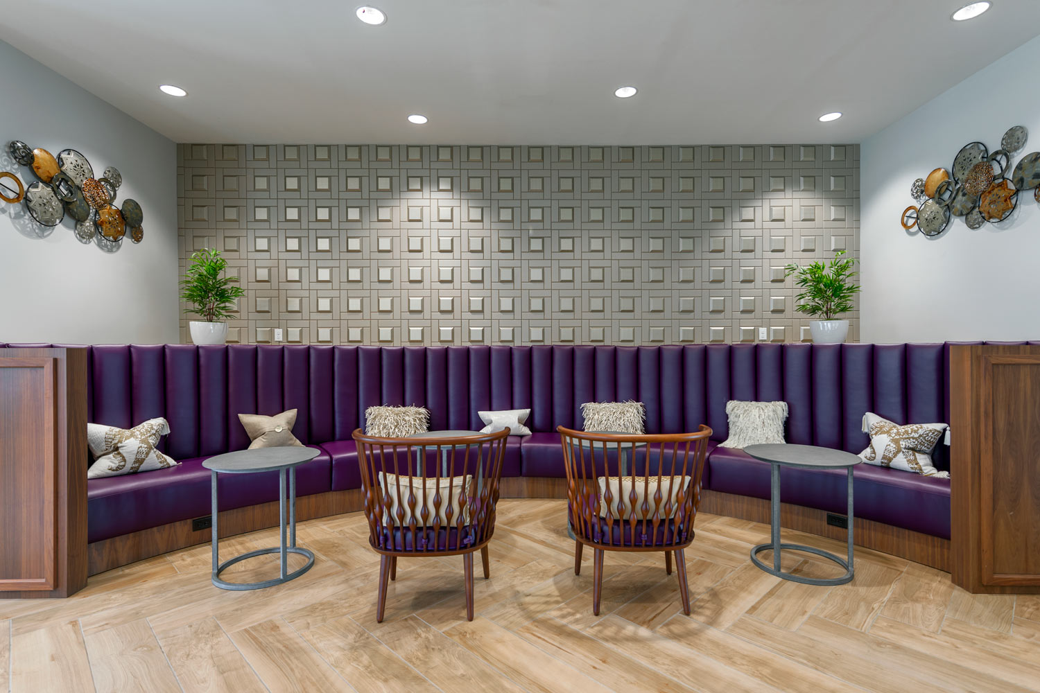 clubhouse with booth seating area, tables, chairs, and modern artwork - luxury apartments near christiana mall