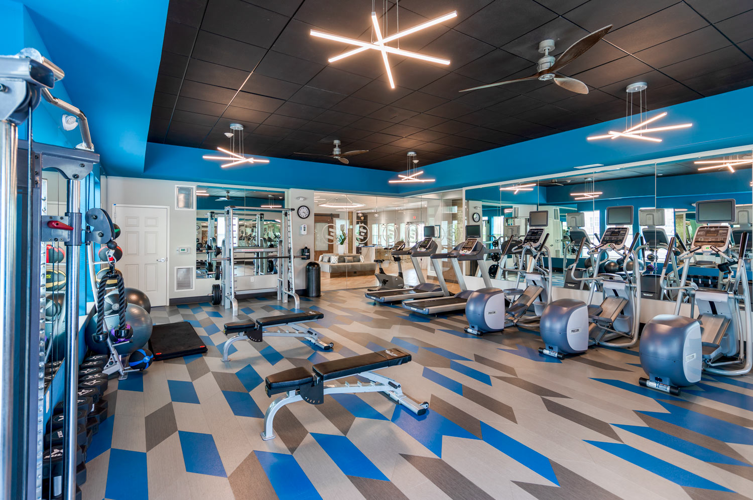 fitness center with various weight and cardio machines - luxury Newark DE apartments