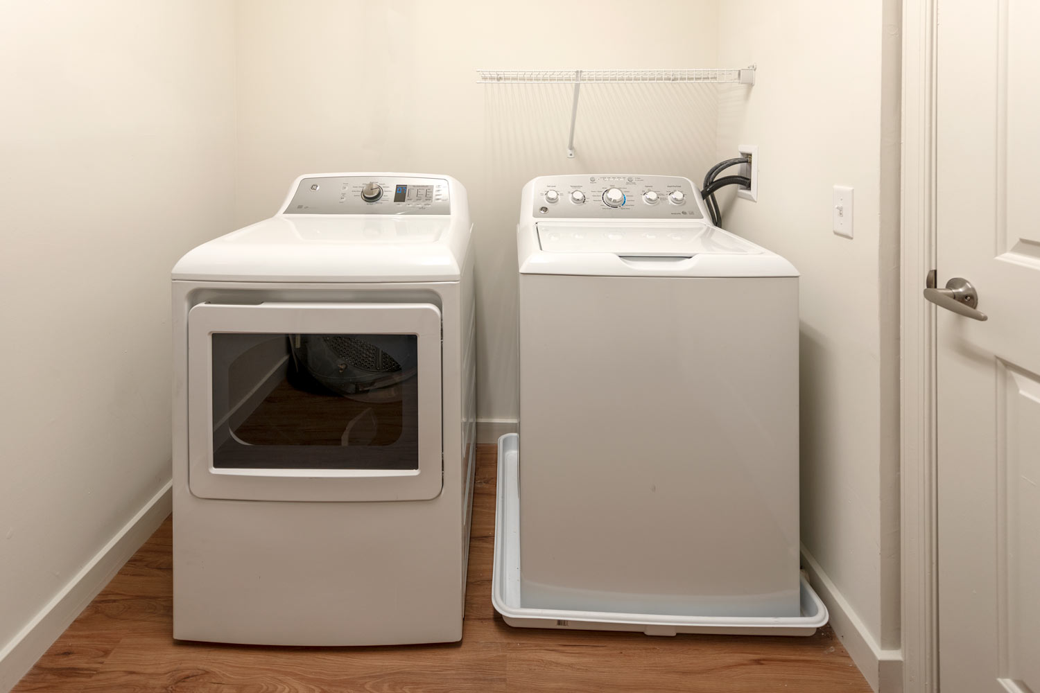 laundry room with washer and dryer - luxury apartments in newark de