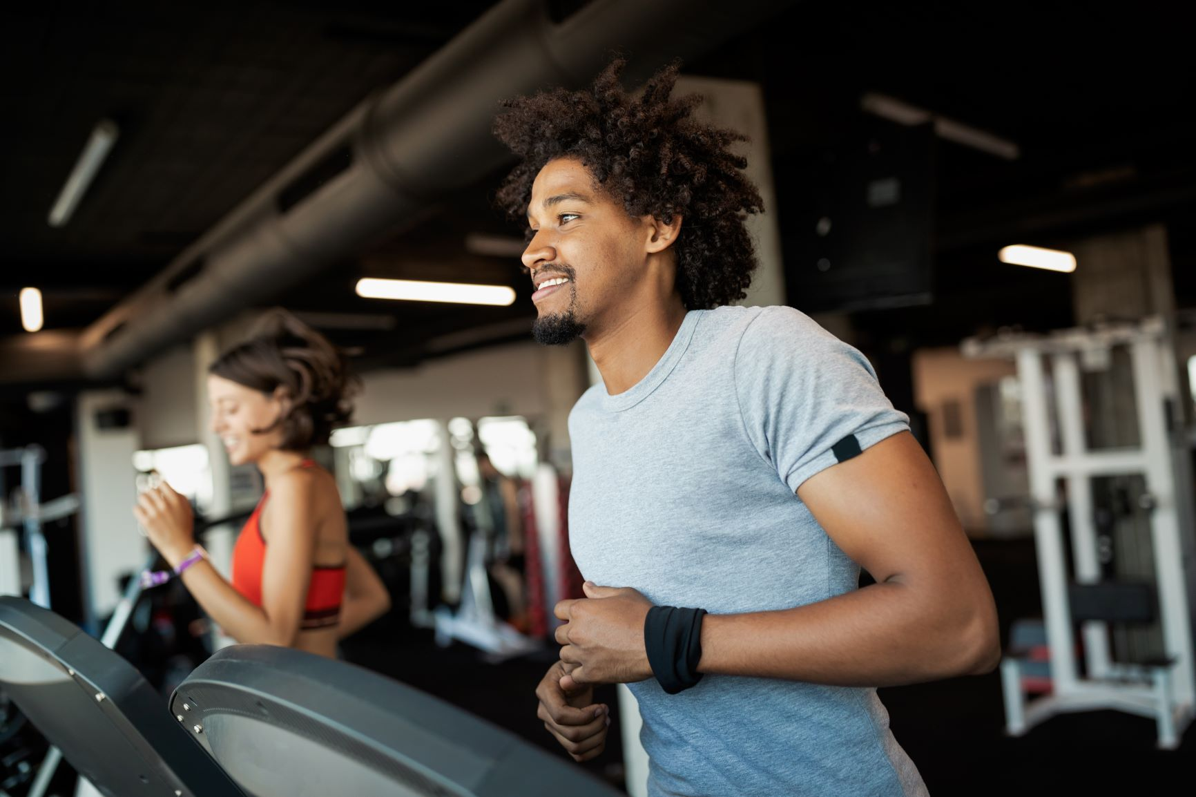 2 people exercising in gym - christiana de apartments